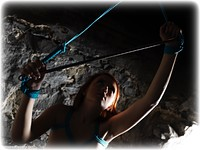 Free bondage photo Jenny Smith rope bondage, barefoot, spreader bar, nude, crotch rope, dungeon, ungagged, redhead