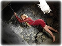 Free bondage photo Bad Dolly ballgag, barefoot, blonde, chains, metal bondage, drama, dress, dungeon