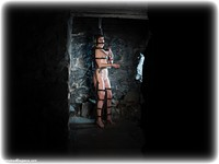 Free bondage photo Lucy Lauren barefoot, handcuffs, blonde, cage, metal bondage, nude, dungeon, ungagged