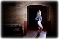 Free bondage photo Ariel Anderssen barefoot, handcuffs, blonde, skirt, leg irons, metal bondage, sweater