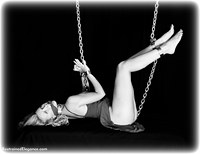 Free bondage photo Alexandra riding crop, ballgown, barefoot, bastinado, shackles, shoes, chains, cloth gag, metal bondage, collar, nude, whipping