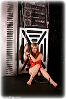 Free bondage photo Amy Allen barefoot, handcuffs, leg irons, chains, metal bondage, pvc