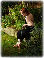 Free bondage photo Anita deBauch barefoot, gown, shackles, sm factory, leg irons, chains, metal bondage, collar, outdoor, dress, ungagged, redhead