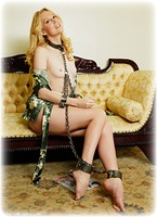 Free bondage photo Ariel Anderssen barefoot, satin, blonde, shackles, blouse, silk, skirt, leg irons, chains, metal bondage, collar, nude, ungagged