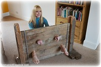 Free bondage photo Ariel Anderssen barefoot, bastinado, humiliation, jeans, tickle, tickling, riding crop, stocks
