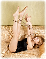 Free bondage photo Delta barefoot, handcuffs, silk, leg irons, cloth gag, metal bondage