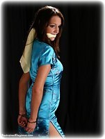 Free bondage photo Jasmine N barefoot, handcuffs, satin, silk, leg irons, chinese dress, cloth gag, metal bondage