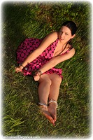 Free bondage photo Temptress Kate barefoot, handcuffs, brunette, leg irons, metal bondage, outdoor, dress, ungagged