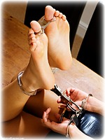 Free bondage photo Kayla Louise barefoot, handcuffs, hogtie, leg irons, metal bondage, thumbcuffs, dress, ungagged