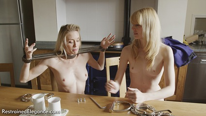 Bondage photo pic picture Ariel Anderssen and Katy Cee barefoot, satin, handcuffs, blonde, blouse, silk, skirt, leg irons, metal bondage, nude, nude in metal, dress, ungagged, yoke