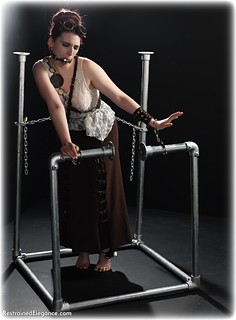 Bondage photo pic picture Roswell Ivory ballgag, barefoot, handcuffs, historical, blouse, skirt, leg irons, chains, metal bondage, ungagged, redhead