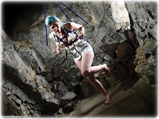 Bondage photo pic picture Kitty Quinzell barefoot, spreader bar, dress, dungeon, topless, ungagged, rope bondage