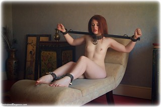 Bondage photo pic picture Helen Stephens barefoot, leg irons, metal bondage, nude, nude in metal, ungagged, redhead, yoke