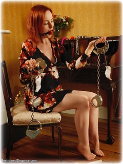 Bondage photo pic picture Anita deBauch ballgag, barefoot, handcuffs, self bondage, leg irons, nude, dress, ungagged, redhead