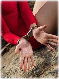 Bondage photo pic picture Ariel Anderssen barefoot, handcuffs, blonde, leg irons, metal bondage, outdoor, dress, ungagged