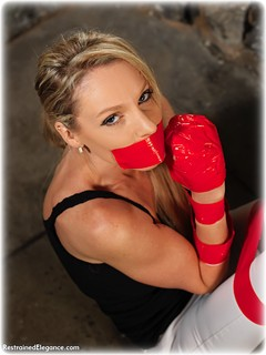 Bondage photo pic picture Angel Price barefoot, blonde, bondage tape, jeans, tape gag, dungeon