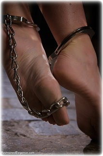 Bondage photo pic picture Sophia Smith barefoot, handcuffs, blouse, brunette, business wear, leg irons, metal bondage, dungeon