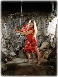 Bondage photo pic picture Hannah Claydon barefoot, satin, handcuffs, blonde, silk, leg irons, chains, chinese dress, metal bondage, thriller, dungeon, ungagged