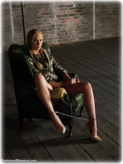 Bondage photo pic picture Ariel Anderssen barefoot, satin, handcuffs, blonde, shoes, humiliation, silk, leg irons, metal bondage, drama, dress, ungagged