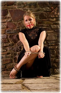 Bondage photo pic picture Penny Lee ballgag, ballgown, barefoot, handcuffs, blonde, leg irons, metal bondage, outdoor, dress