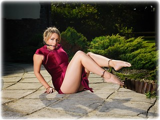 Bondage photo pic picture Penny Lee ballgag, barefoot, handcuffs, blonde, slave training, leg irons, chains, chinese dress, metal bondage, thriller, outdoor, ungagged, romance, velvet