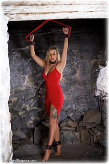 Bondage photo pic picture Katie Anna rope bondage, ballgown, barefoot, blonde, leather bondage, spreader bar, dress, dungeon, ungagged
