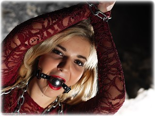 Bondage photo pic picture Bad Dolly ballgag, barefoot, blonde, chains, metal bondage, drama, dress, dungeon