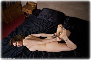 Bondage photo pic picture Nicky Phillips ballgag, barefoot, bedroom, handcuffs, hogtie, brunette, leg irons, metal bondage, nude, ungagged