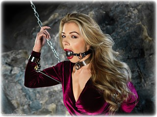 Bondage photo pic picture Tillie ballgag, ballgown, barefoot, blonde, shackles, shoes, sm factory, leg irons, chains, spreader bar, metal bondage, dungeon, ungagged, velvet