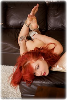 Bondage photo pic picture Scarlett Foxett barefoot, handcuffs, hogtie, leg irons, metal bondage, nude, nude in metal, ungagged, redhead