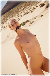 Bondage photo pic picture Ariel Anderssen ballgag, barefoot, handcuffs, blonde, leg irons, metal bondage, nude, nude in metal, outdoor