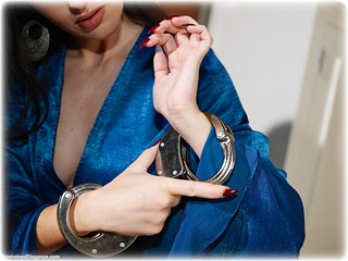 Bondage photo pic picture Sophia Smith barefoot, handcuffs, bit gag, brunette, leg irons, metal bondage, dress, ungagged