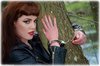 Bondage photo pic picture Zoe Page handcuffs, boots, leg irons, metal bondage, outdoor, pantyhose, dress, ungagged, redhead