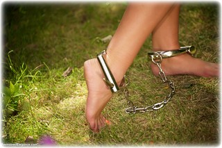 Bondage photo pic picture Lauren Louise globe cuffs, barefoot, bit gag, brunette, leg irons, metal bondage, nude, outdoor