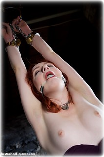 Bondage photo pic picture Aerlise ballgag, ballgown, handcuffs, leg irons, chains, metal bondage, collar, topless, dungeon, redhead