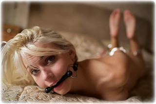 Bondage photo pic picture Chloe T barefoot, bedroom, handcuffs, bit gag, blonde, hogtie, leg irons, metal bondage, nude, nude in metal