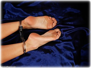 Bondage photo pic picture Natalia Forrest ballgag, barefoot, handcuffs, bedroom, blonde, leg irons, metal bondage, nude