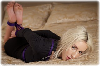 Bondage photo pic picture Hannah Clare barefoot, bedroom, blonde, hogtie, business wear, dress, ungagged, rope bondage