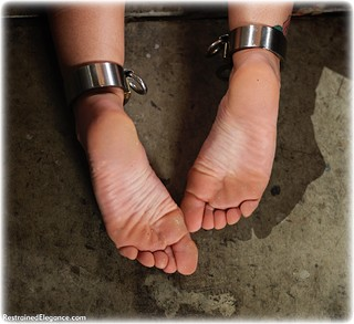 Bondage photo pic picture Millie Fenton ballgag, barefoot, shackles, sm factory, brunette, leg irons, spreader bar, chains, metal bondage, collar, nude, dungeon, ungagged