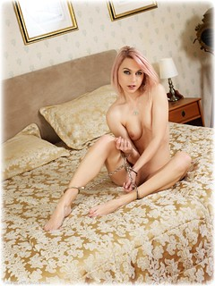Bondage photo pic picture Chloe T barefoot, bedroom, handcuffs, blonde, skirt, socks, leg irons, lingerie, casual clothes, metal bondage, nude, ungagged