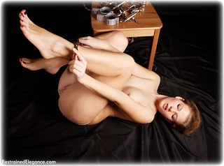 Bondage photo pic picture Albina Rose barefoot, handcuffs, self bondage, shackles, shoes, business wear, leg irons, lingerie, stockings, metal bondage, nude, thumbcuffs, topless, ungagged