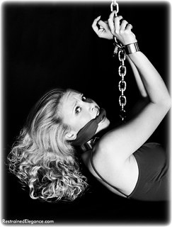 Bondage photo pic picture Alexandra riding crop, ballgown, barefoot, bastinado, shackles, shoes, chains, cloth gag, metal bondage, collar, nude, whipping
