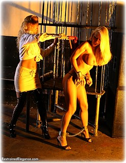 Bondage photo pic picture Alexandra and Petra Morgan girlgirl, blouse, shackles, boots, shoes, leg irons, slave training, chains, lesbian, lingerie, metal bondage, collar, whipping