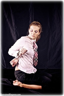 Bondage photo pic picture Albina Rose barefoot, bastinado, handcuffs, blonde, blouse, business wear, leg irons, lingerie, metal bondage, topless