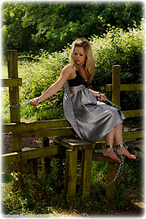 Bondage photo pic picture Amy Allen and Ariel Anderssen girlgirl, ballgown, barefoot, satin, silk, leg irons, chains, lesbian, metal bondage, collar, outdoor, dress, ungagged