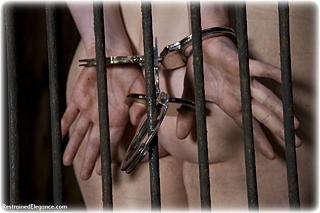 Bondage photo pic picture Amy Allen ballgag, barefoot, handcuffs, cage, leg irons, metal bondage, nude, outdoor, thumbcuffs