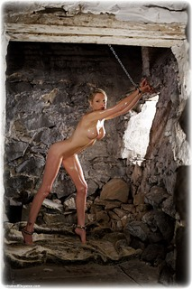 Bondage photo pic picture Angel Price ballgag, barefoot, handcuffs, blonde, hogtie, leg irons, chains, metal bondage, drama, dungeon