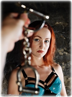 Bondage photo pic picture Anita deBauch ballgag, barefoot, handcuffs, shoes, latex, leg irons, chains, lingerie, metal bondage, dungeon, ungagged, redhead