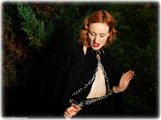 Bondage photo pic picture Anita deBauch barefoot, gown, shackles, sm factory, leg irons, chains, metal bondage, collar, outdoor, dress, ungagged, redhead