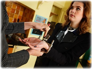 Bondage photo pic picture Aria Wednesday barefoot, handcuffs, blouse, shackles, skirt, leg irons, chains, melodrama, metal bondage, collar, corporal punishment, nude, ungagged, uniform, riding crop